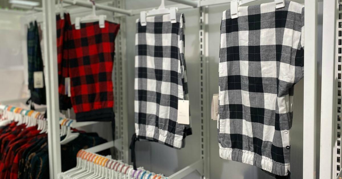 plaid pj pants hanging on a store wall display