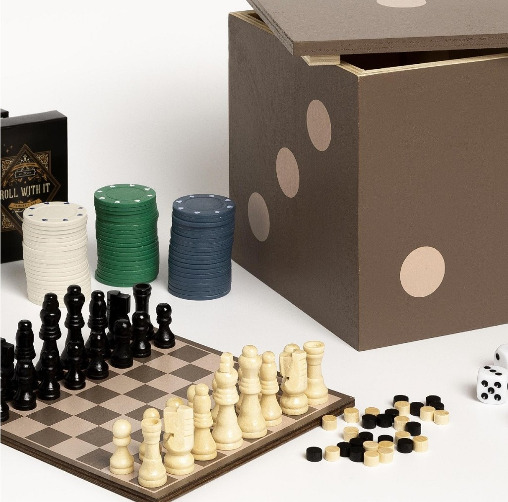 small chess set and poker chips next to box