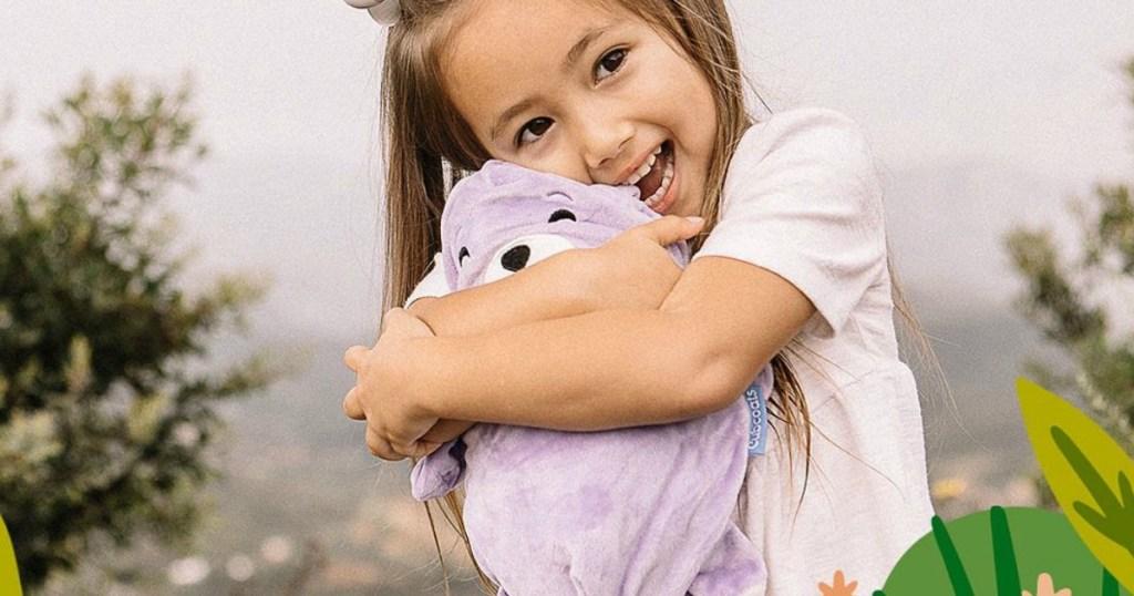 little girl holding a stuffed animal