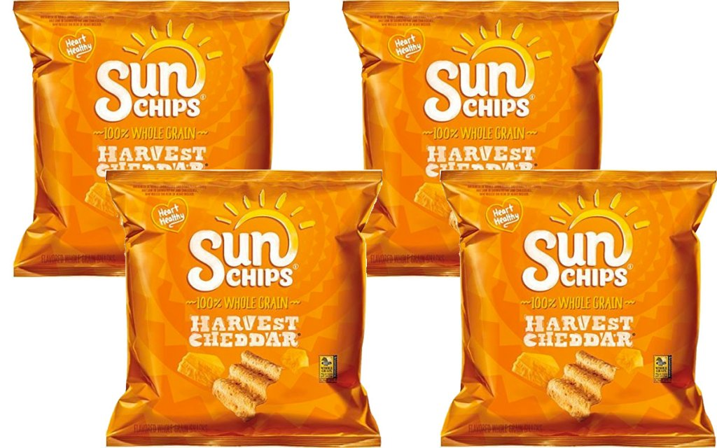 four individual sized bags of harvest cheddar sunchips
