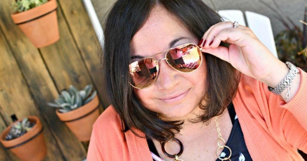 woman wearing mirrored aviators
