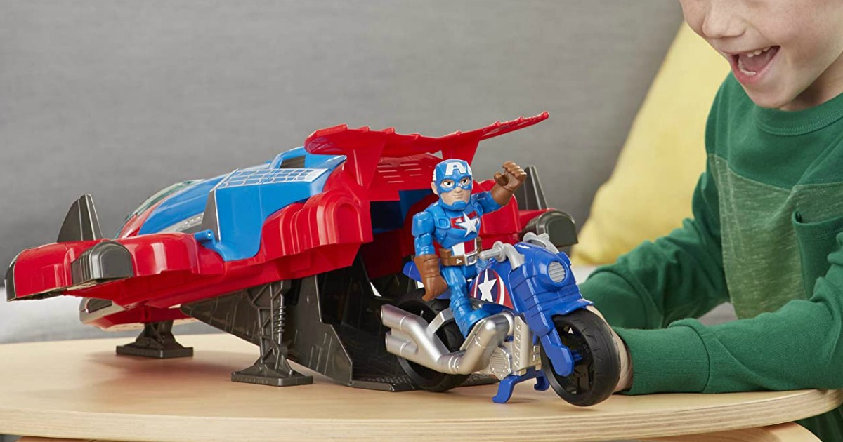 Young boy playing with Super Hero Adventures Spiderman Jetquarters