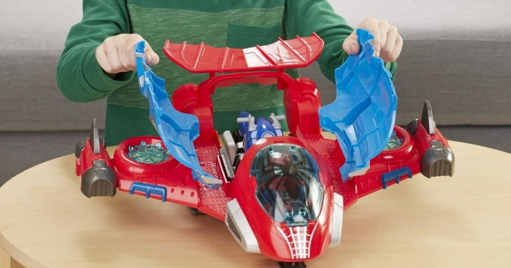Super Her Adventure Spiderman Jetquarters on table with boy
