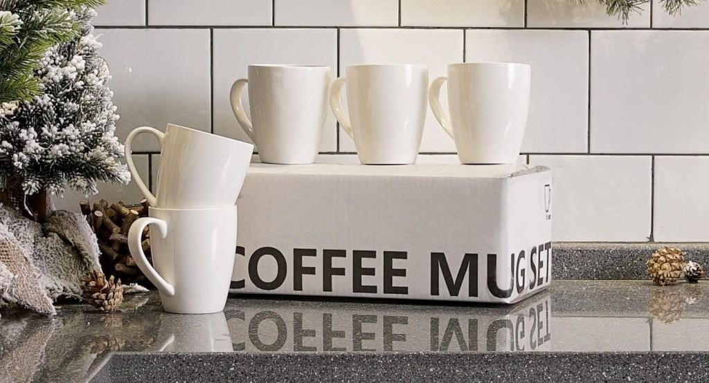 white coffee mugs on a box