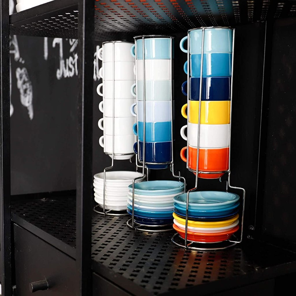 three racks with stackable mugs and saucers