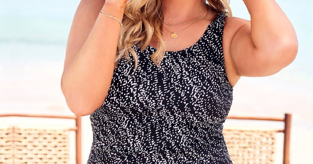 woman in black and white print tankini top at beach