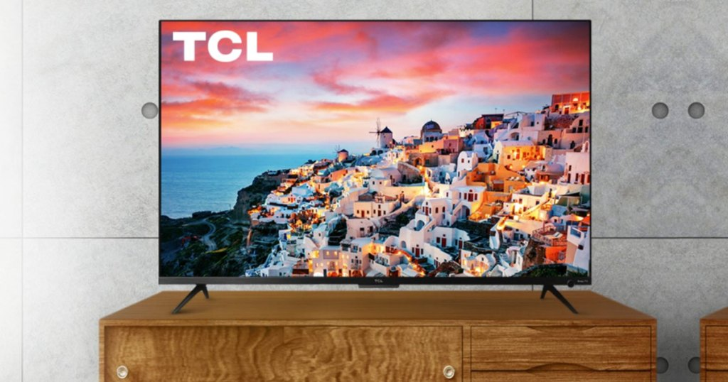 tcl tv on a wood tv stand