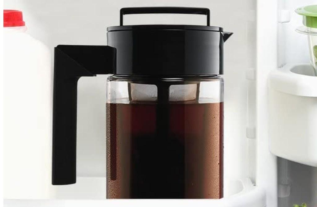 Takeya Patented Deluxe Cold Brew Coffee Maker inside a fridge door