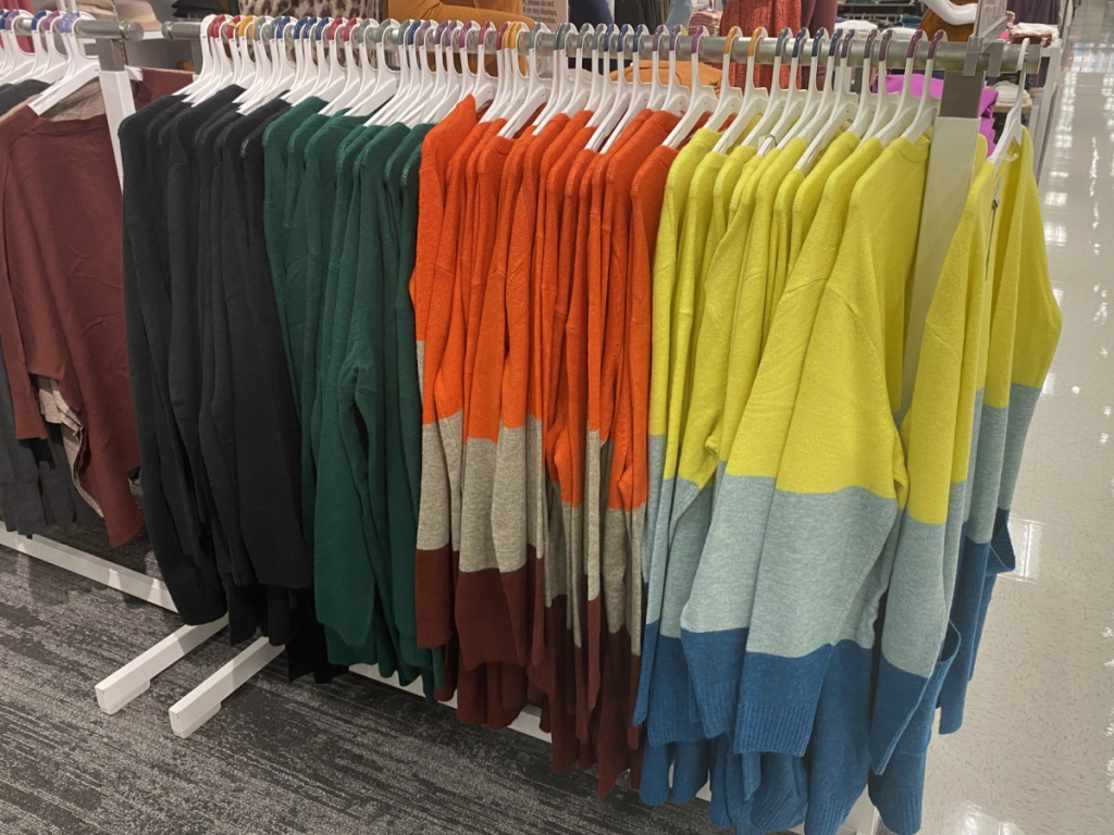 women's colorblock cardigans hanging on a target rack