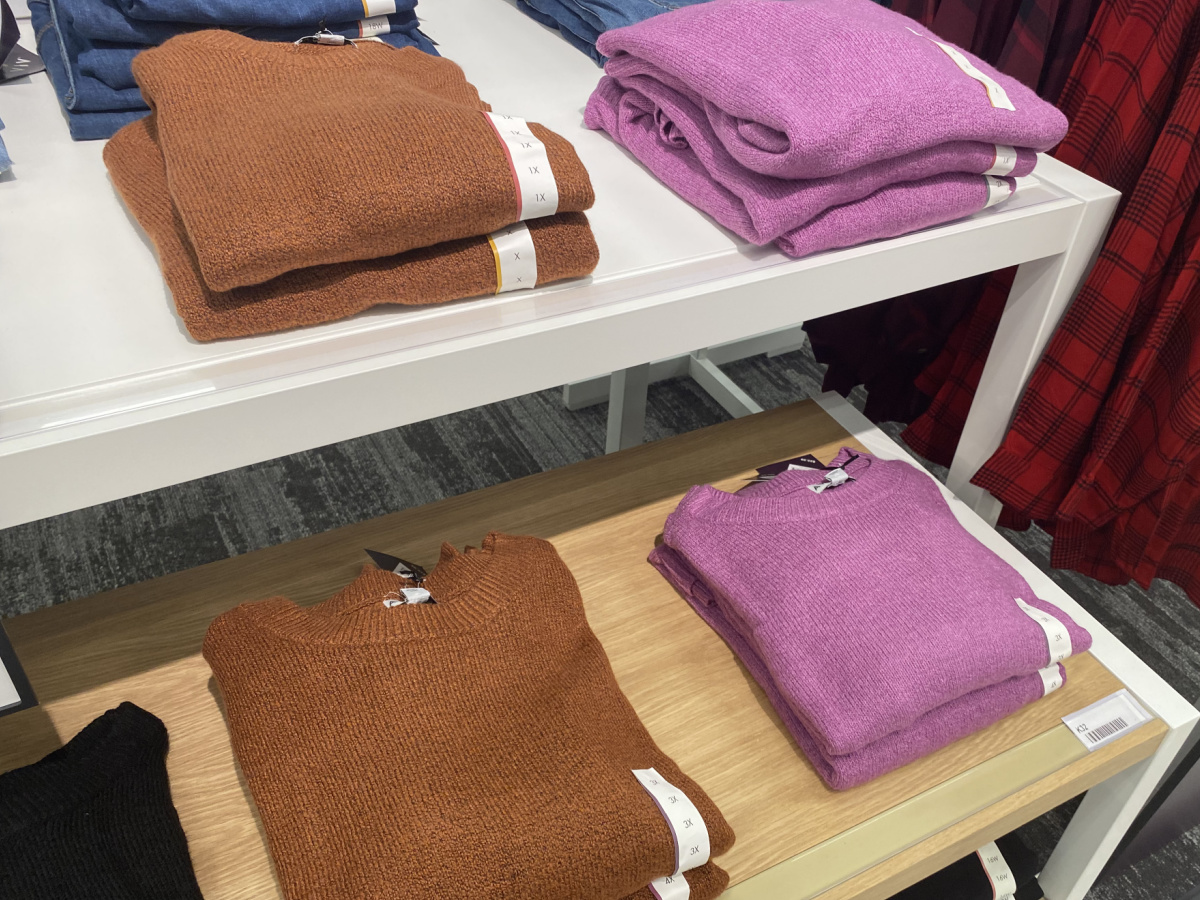 women's sweaters folded on a table at target