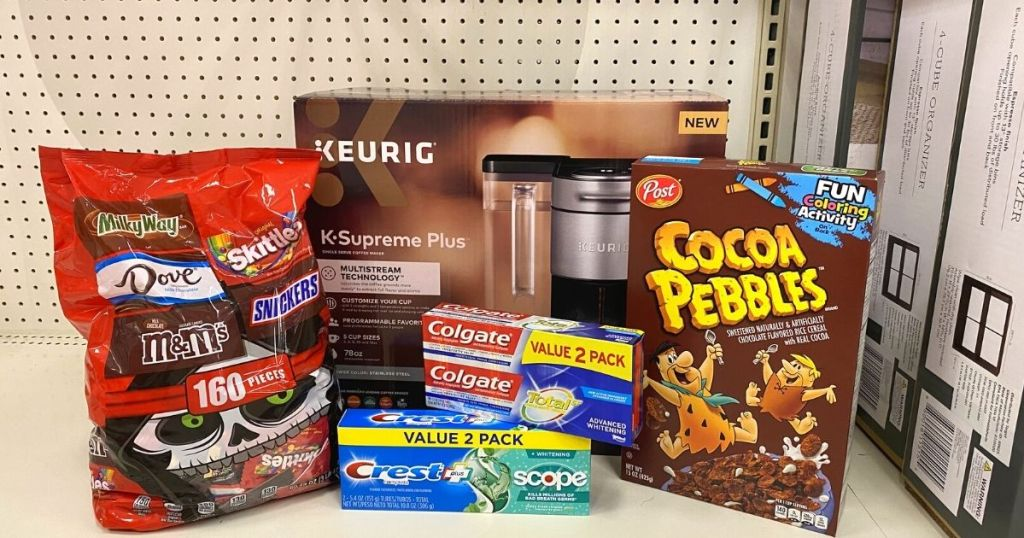 image of halloween candy, keurig machine, colgate, and cocoa pebbles together