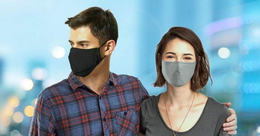 man and woman wearing blac face masks