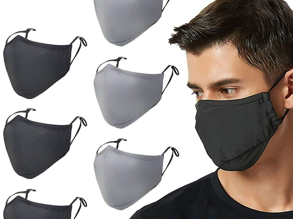 man wearing black mask with black and gray masks beside im