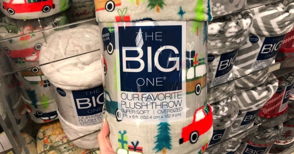 the big one holiday cars plush throw in hand with throws in background