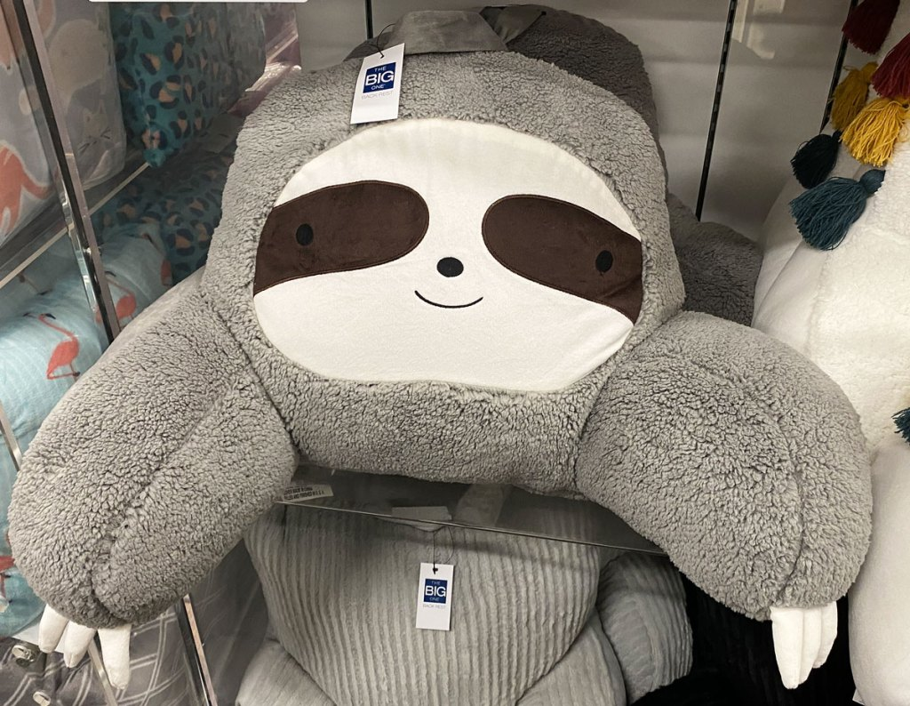 grey sloth shaped backrest pillow on display shelf at kohl's