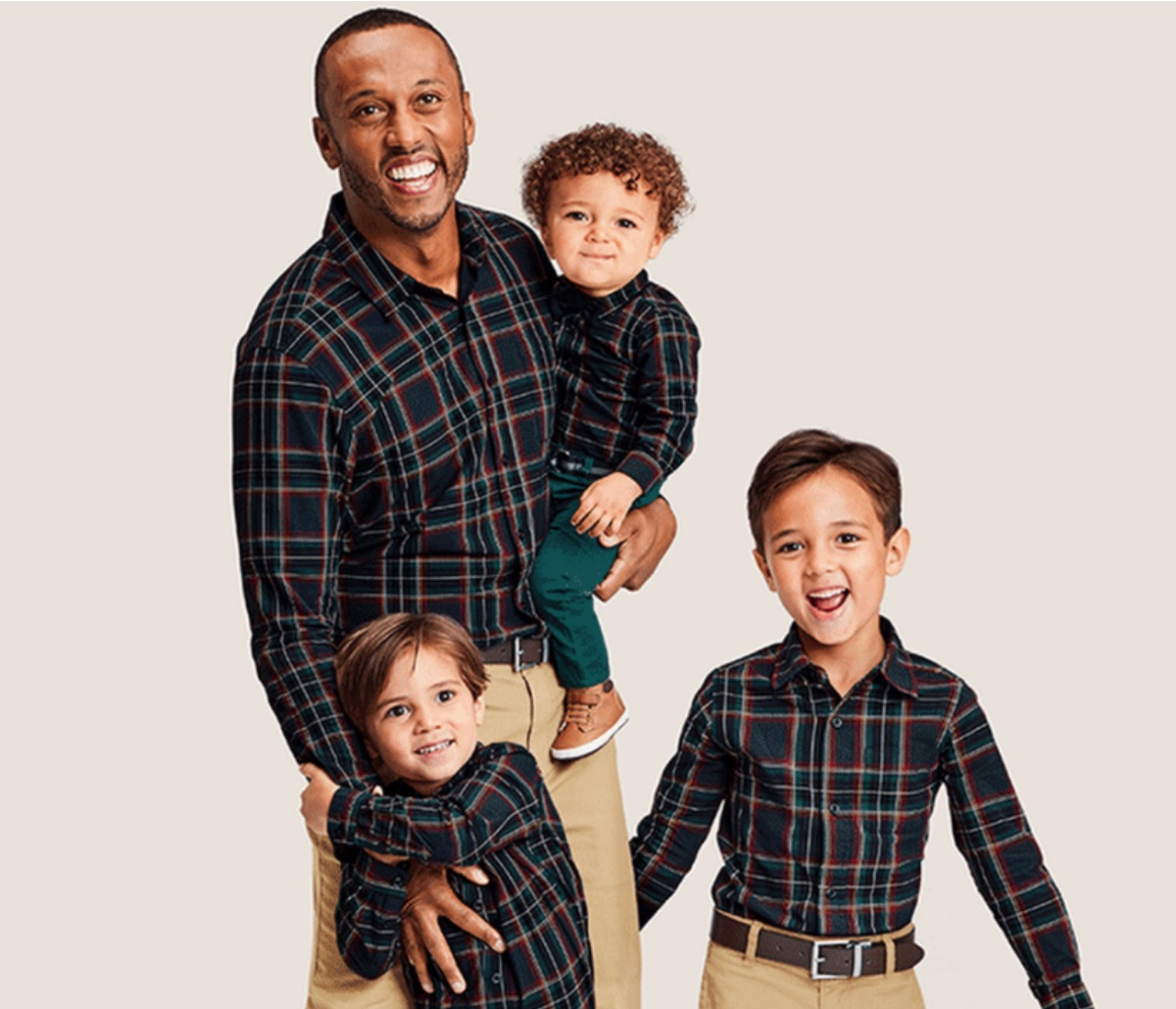 Dad and sons wearing matching shirts