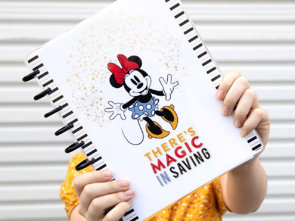 woman holding a minnie mouse The Happy Planner outside
