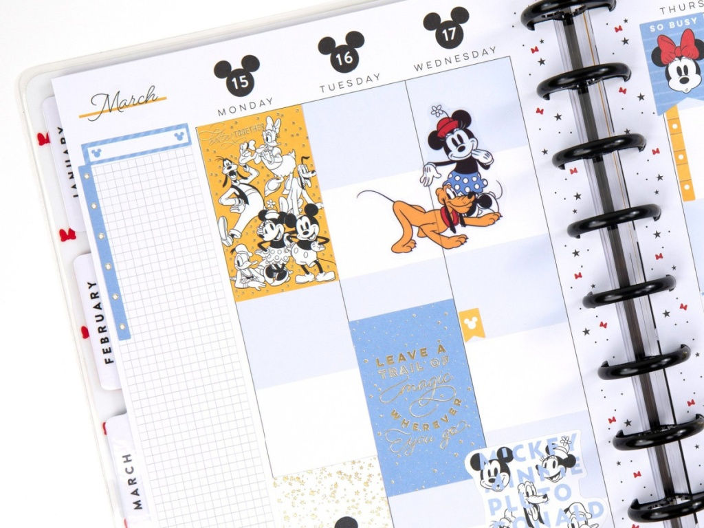 The happy Planner Disney Planner open with disney stickers on the pages