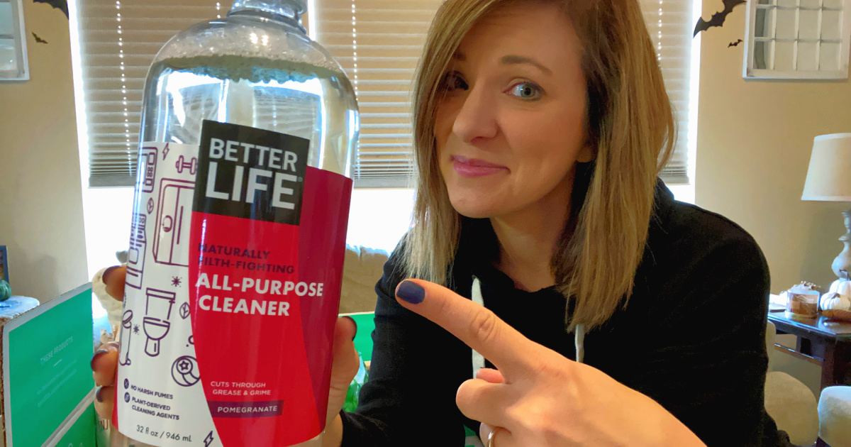 woman holding all purpose cleaner
