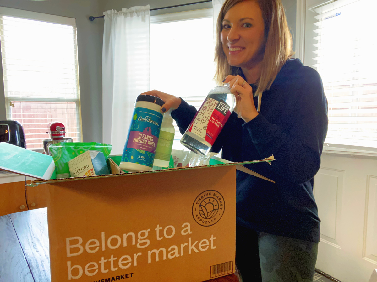 girl holding cleaning supplies from Thrive Market