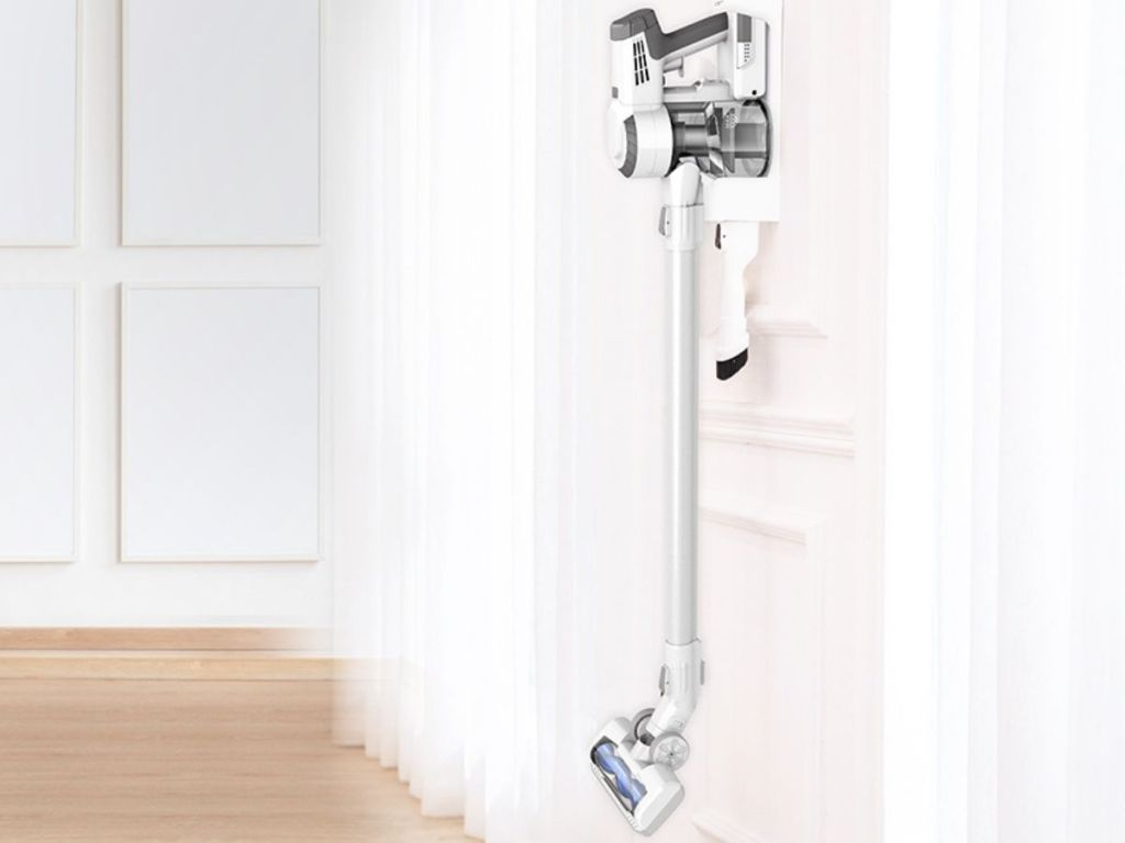 Tineco A10 Spartan Cordless Vacuum hanging on back of door