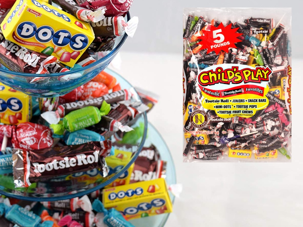 large tiered tray full of Tootsie roll bag candies next to a big 5 pound bag