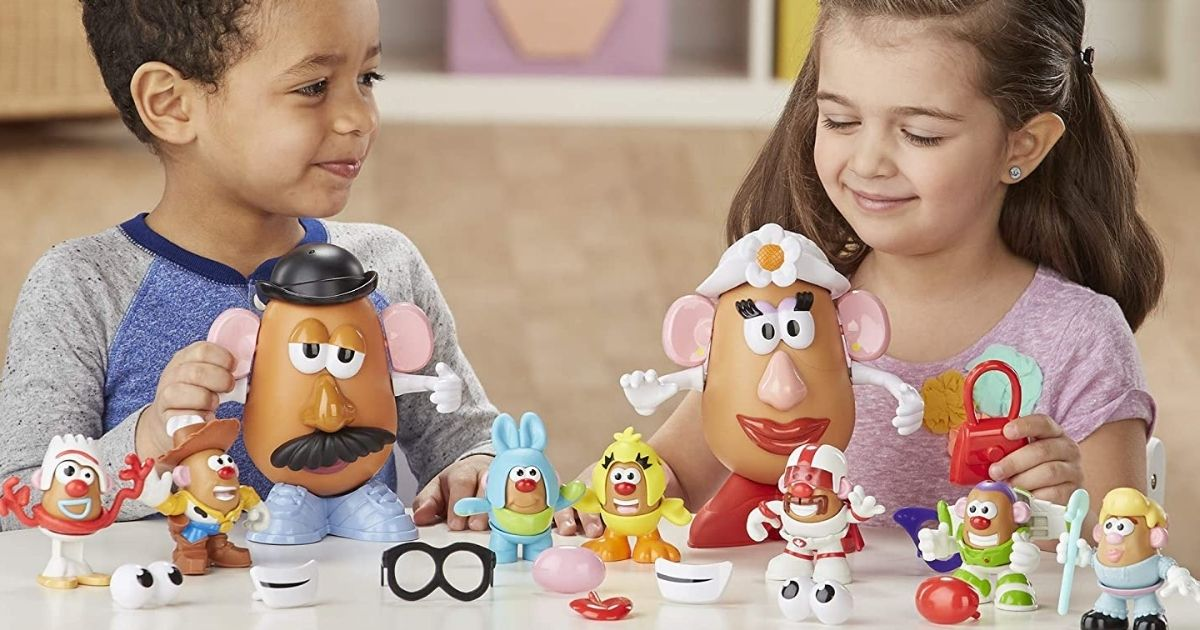 boy and girl playing with Toy Story Andy's Room Mr. Potato Head Set