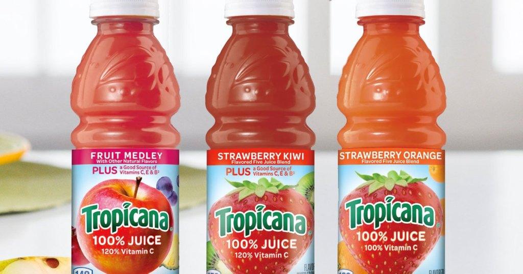 three bottles of tropicana 100% juice in various flavors