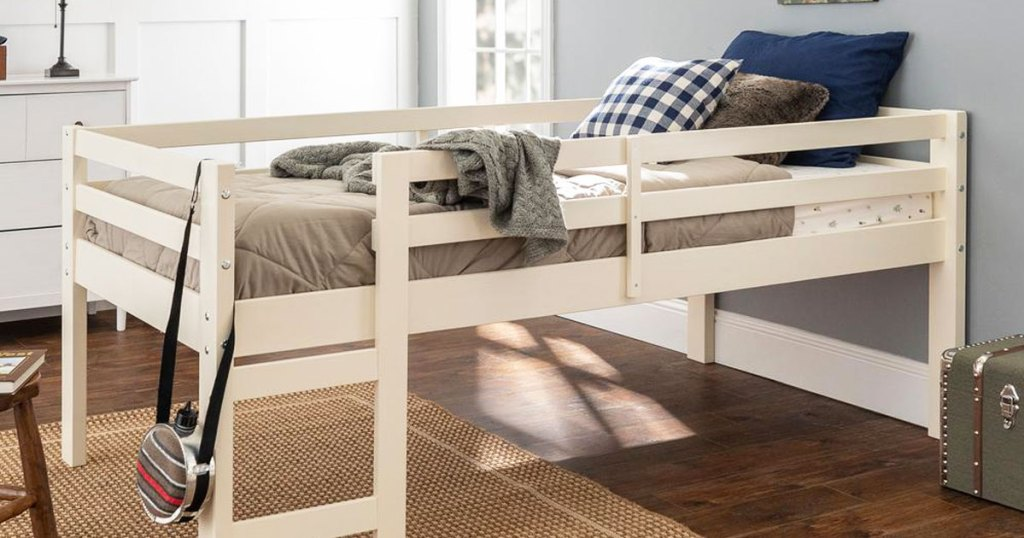 white wood twin size low loft bed in boys room
