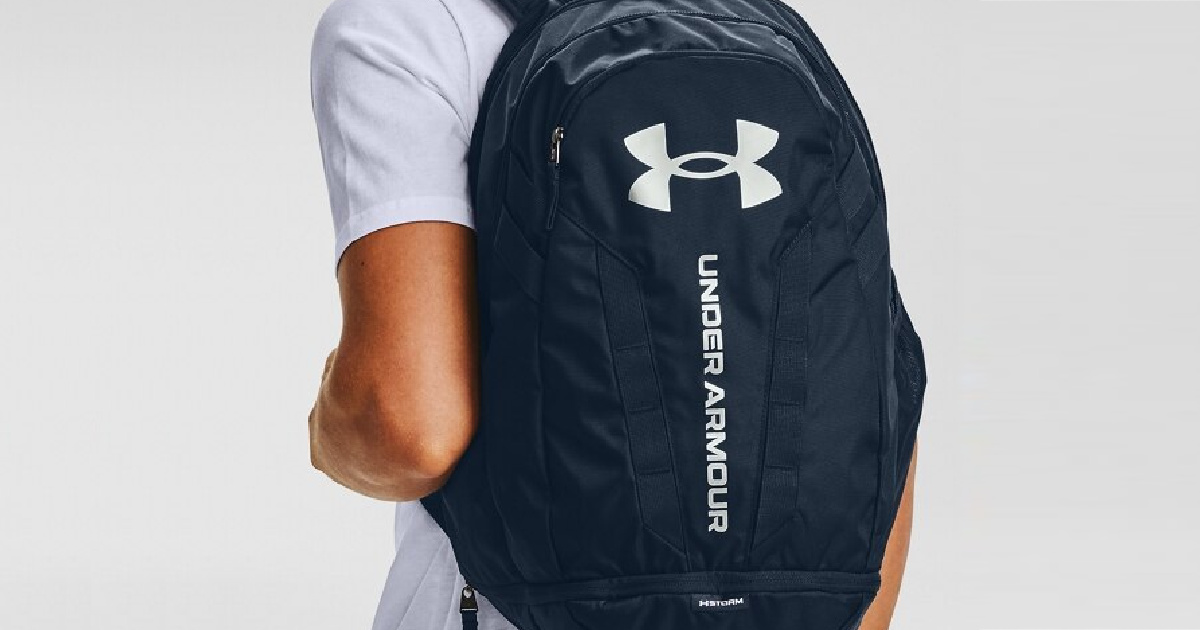 picture of a man from behind wearing an under armour backpack