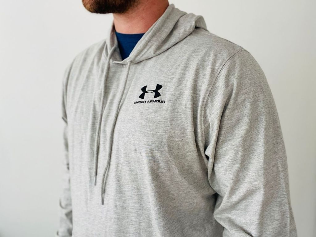 side view of man wearing Under Armour Men's Grey Sweatshirt