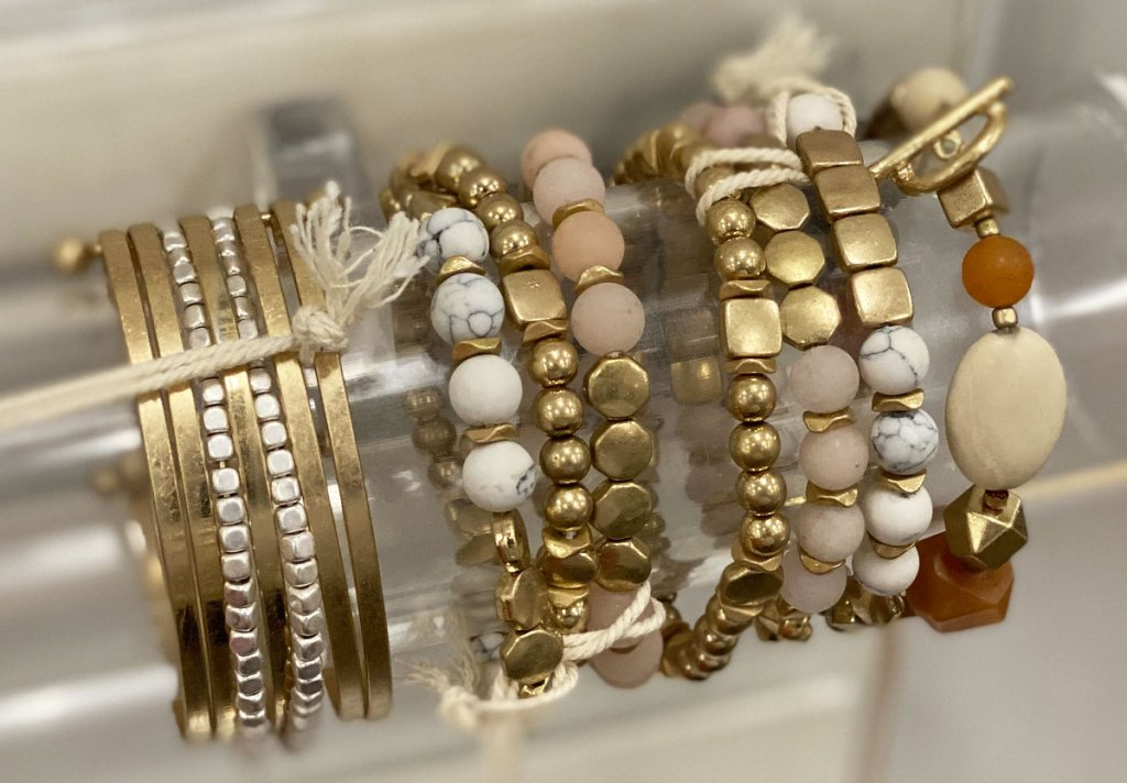 gold-tone beaded bracelets on display at Target