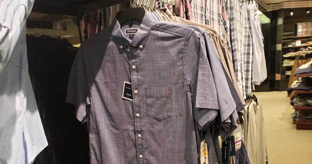 men's shirts hanging on display in store