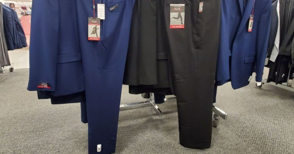 men's dress pants on store display rack