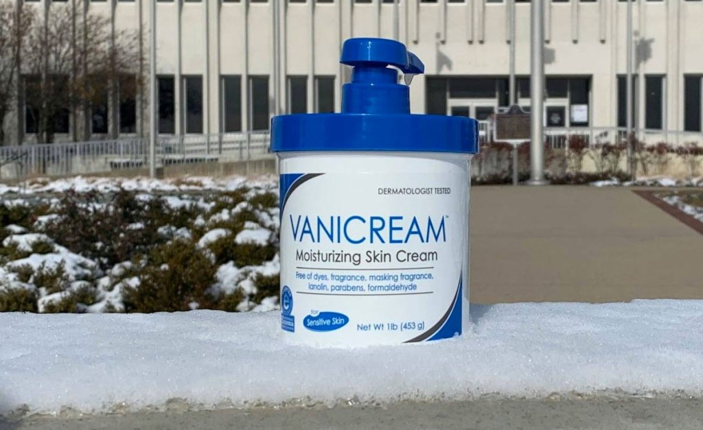 white and blue jar of vanicream moisturizer on snowy bench outside