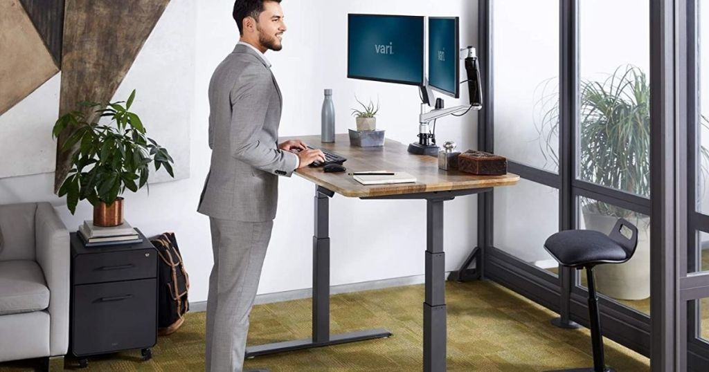 man standing at a standing desk
