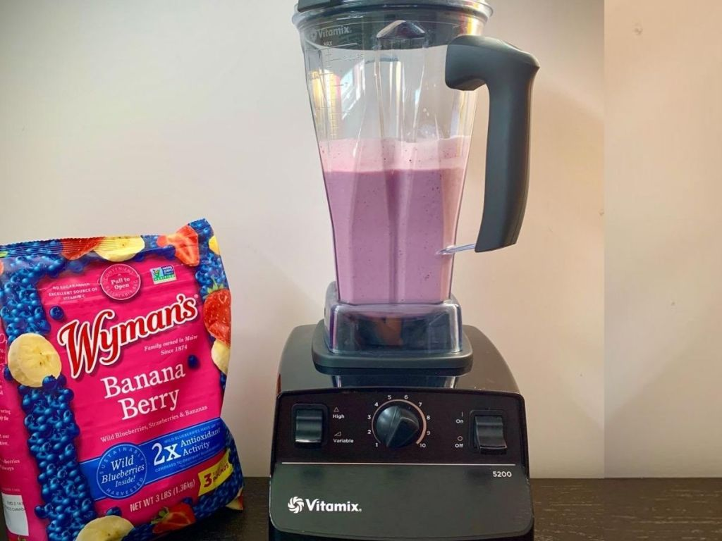 Vitamix blender with pink smoothie in container