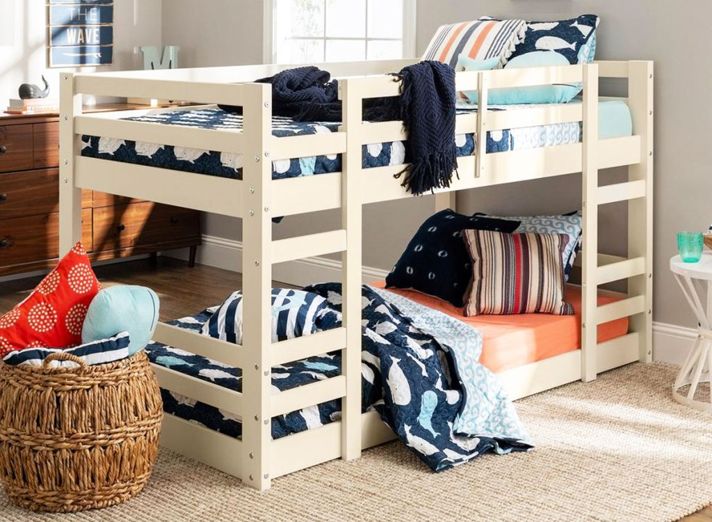 white wood low bunk bed in boys room