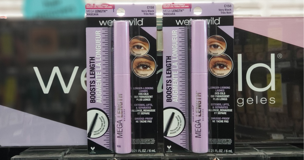 two packages of mascara with brand sign in store