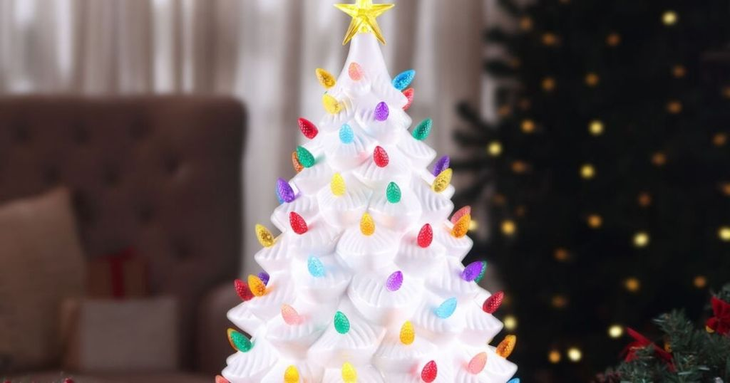 white ceramic christmas tree with lights and gold star