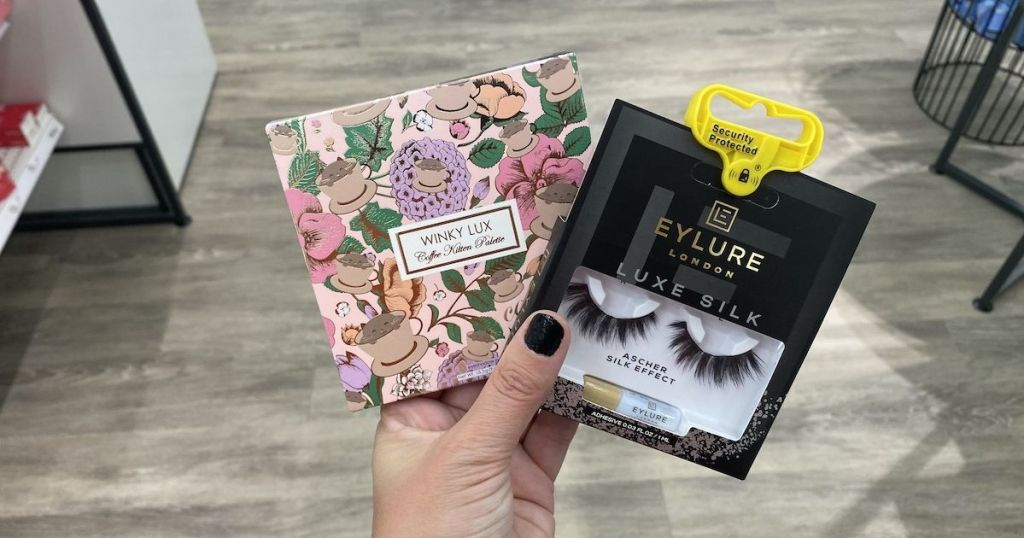 hand holding Winky Lux and Eylure Lashes