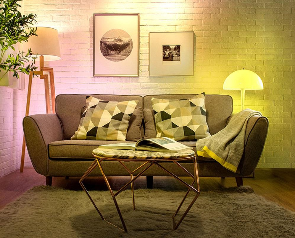 living room with couch and lamps with colored bulbs