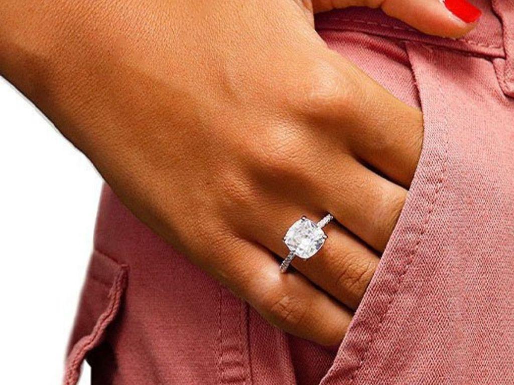 woman's hand wearing oval cut swarovski crystal ring