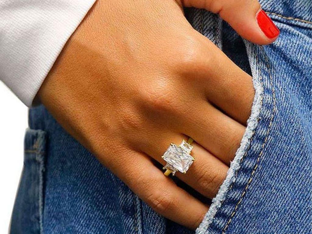 women's three stone square cut swarovski crystal ring on woman's hand