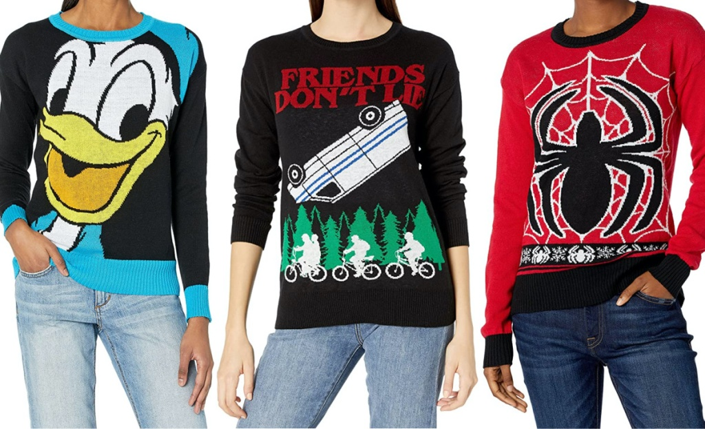 woman in Daffy Duck Christmas sweater, woman in Stranger Things Christmas sweater, and woman in Spiderman Christmas sweater