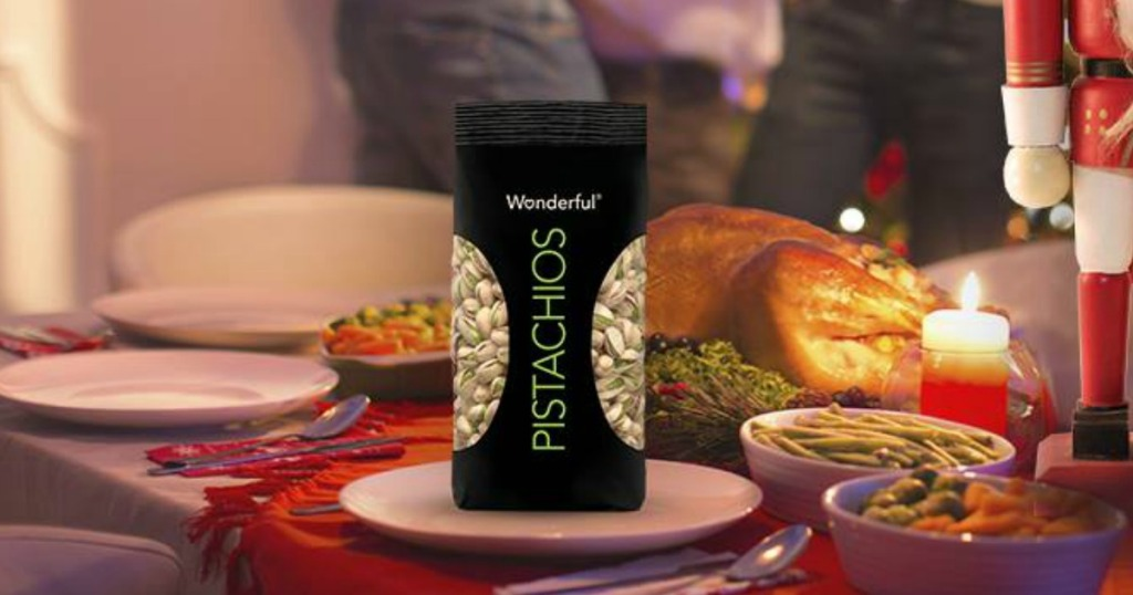 Small bag of pistachio nuts near a holiday feast