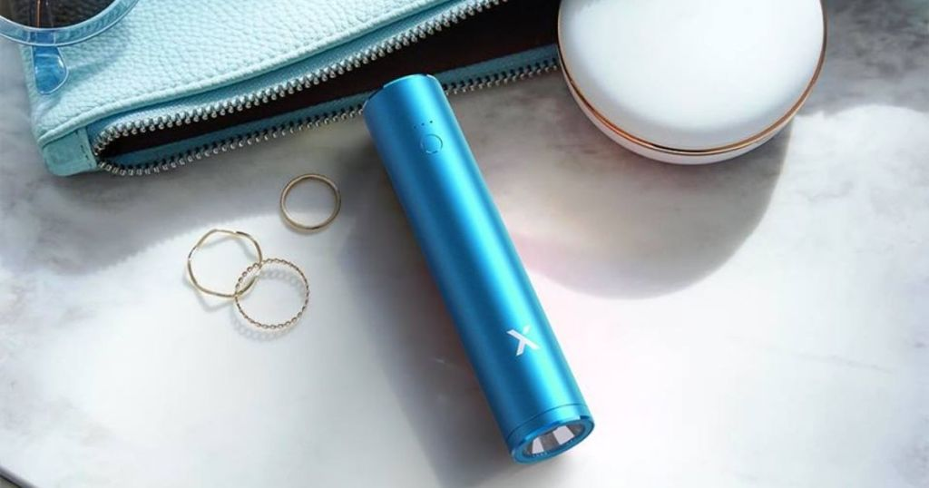 blue lipstick charger with blue purse and rings in background
