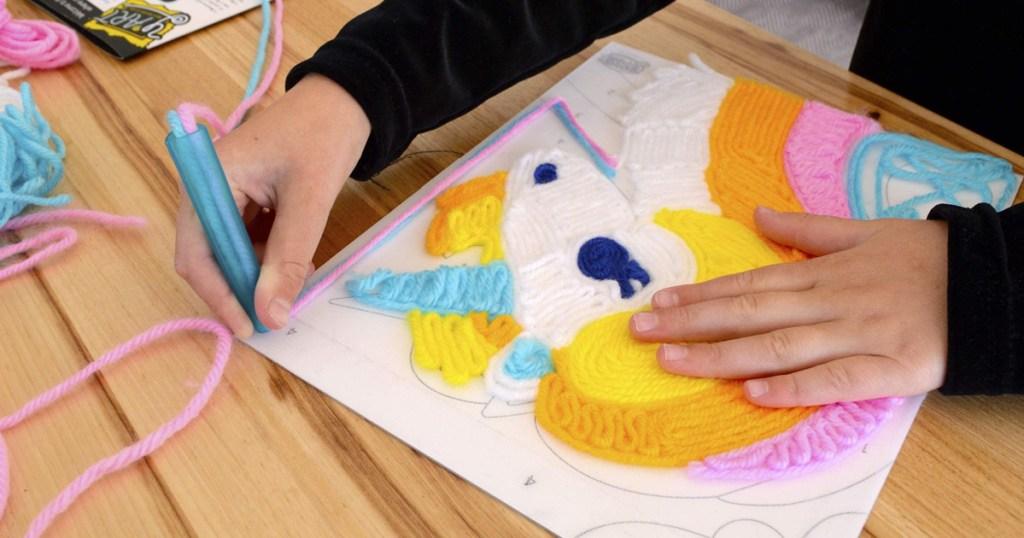 child working on a unicorn art project