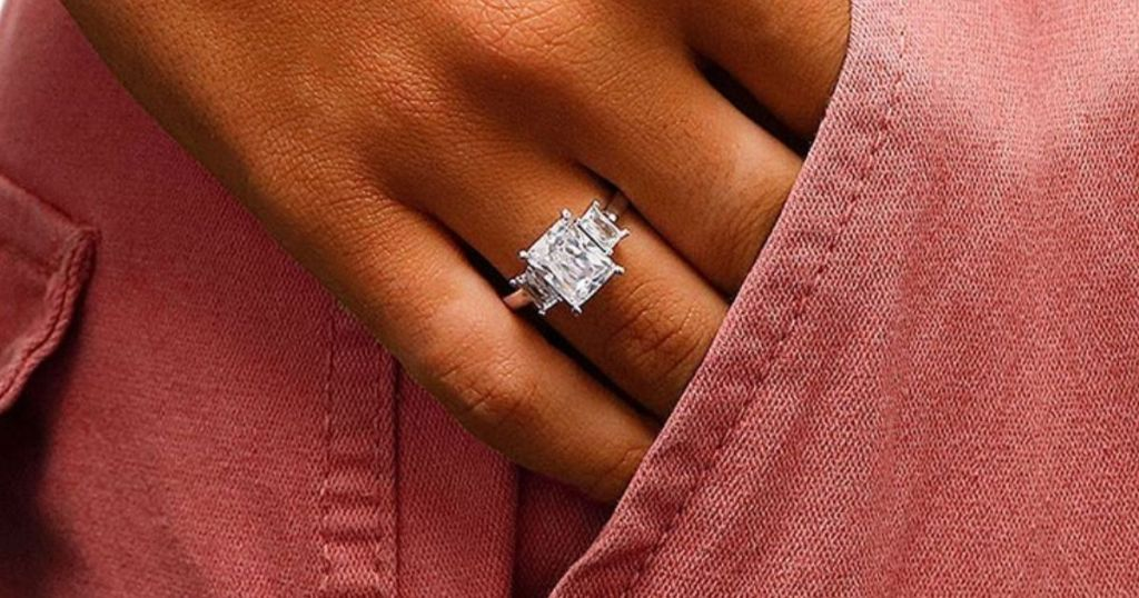 Women's three-stone swarovski crystal ring on woman's hand in pocket