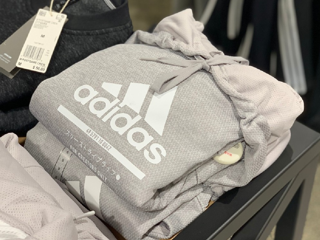 folded up grey hoodies on table inside store